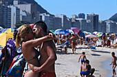 Kissing couple on the beach, Copacabana, Rio de Janeiro, Brazil, South America, America