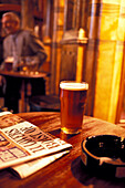 Newspaper and beer glass on a table at Black Friars Pub, London, England, Great Britain, Europe