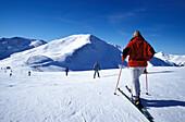 Skiers on slope, Zwolf Gipfel, Saalbach-Hinterklemm, Salzburg (state), Austria