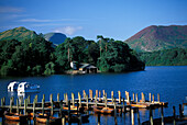 Idyllic lake with boats and jetty, Keswick, Derwent Water National Park, Lake District, Cumbria, England, Great Britain, Europe