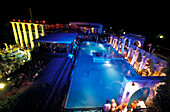 People at the pool of the Baia Imperiale Disco at night, Cattolica, Province of Rimini, Italy, Europe