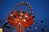 Illuminated fairground ride in the evening, Bad Cannstatt fair, Stuttgart, Baden Wuerttemberg, Germany, Europe