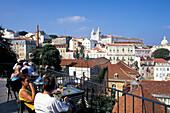People at the terrace of a cafe, Miradouro Santa Luzia, Alfama, Lisbon, Portugal, Europe