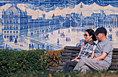 Couple on a bench in front of tiled wall, Azujelos, Miradouro St. Luzia, Alfama, Lisbon, Portugal, Europe