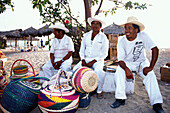Sellers with baskets on the beach, Puerto Vallarta, Jalisco, Mexico, America