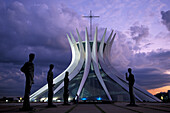Statues in front of Metropolitana Cathedral in the evening, Brasilia, Brazil, South America, America