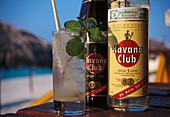 Close up of Mojito Drink and bottles of rum, Varadero Beach, Varadero, Cuba, Caribbean, America