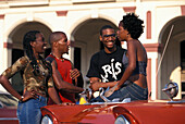 Young people at an old taxi, Havana, Cuba, Caribbean, America