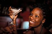 Young woman with Daiquiri Drink at a bar, El Floridita, Havana, Cuba, Caribbean, America