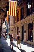 Narrow street in Barri Gotic, Old City of Barcelona, Catalonia, Spain