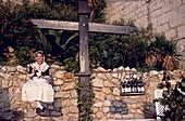 Winners representative is weighed on a balance against wine bottles, Wine Festival, Sitges, Costa de Garraf, Spain