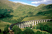 Train on Glenfinnan viaduct, Invernesshire, Scotland, Great Britain, Europe