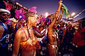 Women in costumes dancing at Mardi Gras, Carnival, Port of Spain, Trinidad and Tobago
