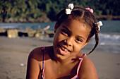 Cheerful girl on the beach, near Cacaos, Samana Peninsula, Dominican Republic, Caribbean