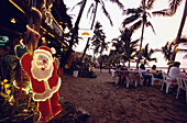 Restaurants along Cabarete beach, Christmas Decorations with Santa Claus in the front, Dominican Republic, Carribean