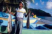 Fisherman with fresh fish near Cacaos, Samana Peninsula, Dominican Republic, Caribbean