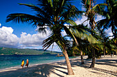 Two people walking along the beach, Cahio Levantado, Bahia de Samana, Samana Peninsula, Dominican Republic, Antilles, Caribbean