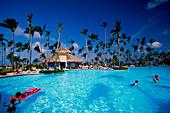 Pool, Hotel, People, People swimming in a pool at Gran Paradise Resort in Bavaro Dominican Republic