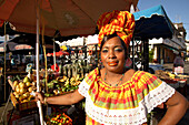 Woman wearing a traditional hat, Fruit vendor at the market, Pointe-a-Pitre, Grande Terre, Guadeloupe, Caribbean Sea, America