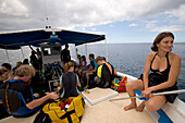 People on a boat of Les Heures Saines Diving School, Bouillante, Basse-Terre, Guadeloupe, Caribbean Sea, America