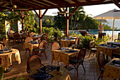 Pool, Tables, Chairs, Dinner Room, Pool with tables and chairs in the front at Hotel Restaurant Le Rayon Vert, Deshaies, Basse-Terre, Guadeloupe, Caribbean Sea, America