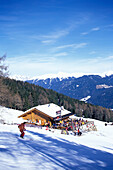 View of ski hut at snowy mountain side, Olang, Kronplatz, Plan de Corones, Dolomites, South Tyrol, Italy, Europe