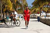 Jogger at the promenade of South Beach, Miami, Florida USA, America