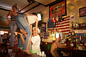 Girls are dancing on the bar while getting touched, Lagecko Bar, Duval Street Key West, Florida, USA