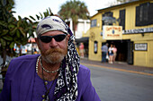 Local artist with a hairdress and sunglasses, Key West, Florida Keys, Florida, USA