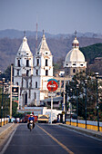 Traffic and white church of Chihuatlan, Chihuatlan, Jalisco, Mexico