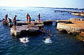 People swimmnig, Beach near Porec, Istria, Croatia