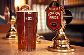 Close up of a glass of beer, The Black Friars Pub, Queen Victoria Street, London, England, Great Britain, Europe