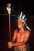 One young man with feather decorations and facial painting, Native South American Tarianos, Amazonas, Brazil