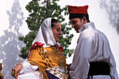 Couple wearing traditional clothes dancing, Folklore, San Miquel, Ibiza, Spain