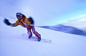 Cheering snoboarder on slope, Hintertux, Hintertux Glacier, Zillertal, Tyrol, Austria