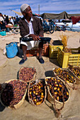 Local man selling dates on the market, Tozeur market, Tunesia