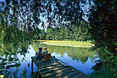Senior couple having a picnic at lakeshore