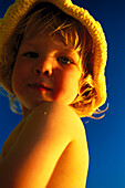 Small child, girl on the beach, wearing a sunhat, Anse Kerlan, Praslin, Seychelles, Indian Ocean