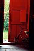 Childrens bike, bicycle stood in the hallway, North Wales, Wales, Great Britain