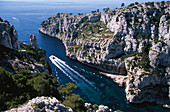 High angle view at rocky coast and boat, Calanque d'En-Vau, Cote d´Azur, Bouches du Rhone, Provence, France, Europe