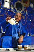 Tuareg Mohamed Jallali pouring peppermint tea into a glass, Essaouira, Marocco
