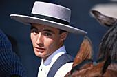Young man in traditional costume at Feria de la Manzanilla, Sanlucar de Barrameda, Cadiz, Andalusia, Spain, Europe