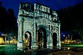 Illuminated triumphal arch at night, Orange, Provence, France, Europe