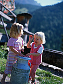 Two little girls, Two little girls playing and having fun, Ramsau am Bachstein, Styria, Austria