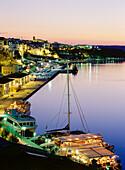 Moll de Ponent, dock area, floating restaurant, boats, harbour, townscape of Maó, Mahon, Menorca, Minorca, Balearic Islands, Mediterranean Sea, Spain