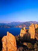 Woman h iking, Les Calanche, near Porto, west coast Corsica, France
