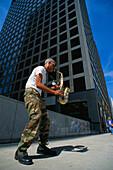Street musician, man playing the saxophone, Chicago, Illinois, USA