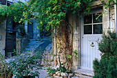 Door and alley at Lacoste, Luberon, Vaucluse, Provence, France, Europe