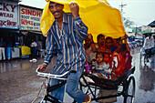Rickshaw, plastic tarpaulin, monsoon , Varanasi, Benares, Uttar Pradesh, India