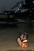 Praying pilgrim , Ganges river, Dasaswamedh Ghat, Varanasi, Benares, Uttar Pradesh, India